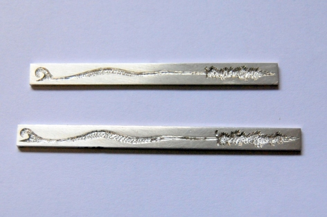 Silver with engraved design